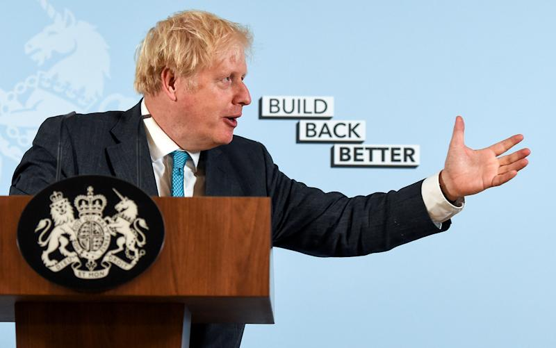 British Prime Minister Boris Johnson delivers a speech at Exeter College Construction Centre, part of Exeter College in Exeter, Britain September 29, 2020. Finnbarr Webster/Pool via REUTERS TPX IMAGES OF THE DAY
