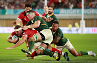 """It takes two South African defenders to stop rampaging Tyler Ardron of Canada in this shot from Adam Pretty (Getty Images). The strength of will is clear to see. """"The fast shutter speed allows me to freeze the moment of impact from the other players whilst they are all off the ground,"""" says Adam. South Africa won the game 66 - 7."""