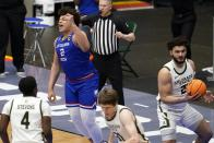 Louisiana Tech forward Kenneth Lofton Jr. (2) celebrates sinking a shot as Colorado State's Isaiah Stevens (4), Adam Thistlewood, bottom center, and David Roddy, right, run past in the second half of an NCAA college basketball game in the NIT, Sunday, March 28, 2021, in Frisco, Texas. The shot that came with only a few seconds left on the clock helped the Colorado State to the 76-74 win. (AP Photo/Tony Gutierrez)