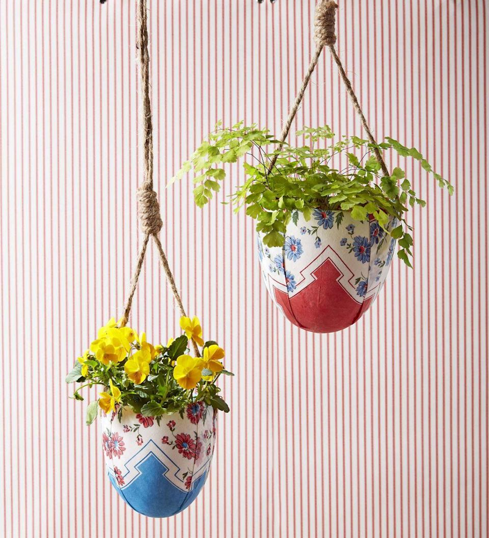 """<p>For moms with a green thumb give a gift that keeps on giving – a live plant nestled in a custom covered ceramic planter.<strong><br></strong></p><p><strong>To make</strong>: Wrap a ceramic hanging planter with a handkerchief, overlapping where necessary to make it lay flat. Use Mod Podge to adhere to the planter.</p><p><a class=""""link rapid-noclick-resp"""" href=""""https://www.amazon.com/MyGift-Ceramic-Hanging-Planters-Succulent/dp/B01KWH3188/ref=sr_1_27?tag=syn-yahoo-20&ascsubtag=%5Bartid%7C10050.g.2357%5Bsrc%7Cyahoo-us"""" rel=""""nofollow noopener"""" target=""""_blank"""" data-ylk=""""slk:SHOP PLANTERS"""">SHOP PLANTERS</a></p>"""