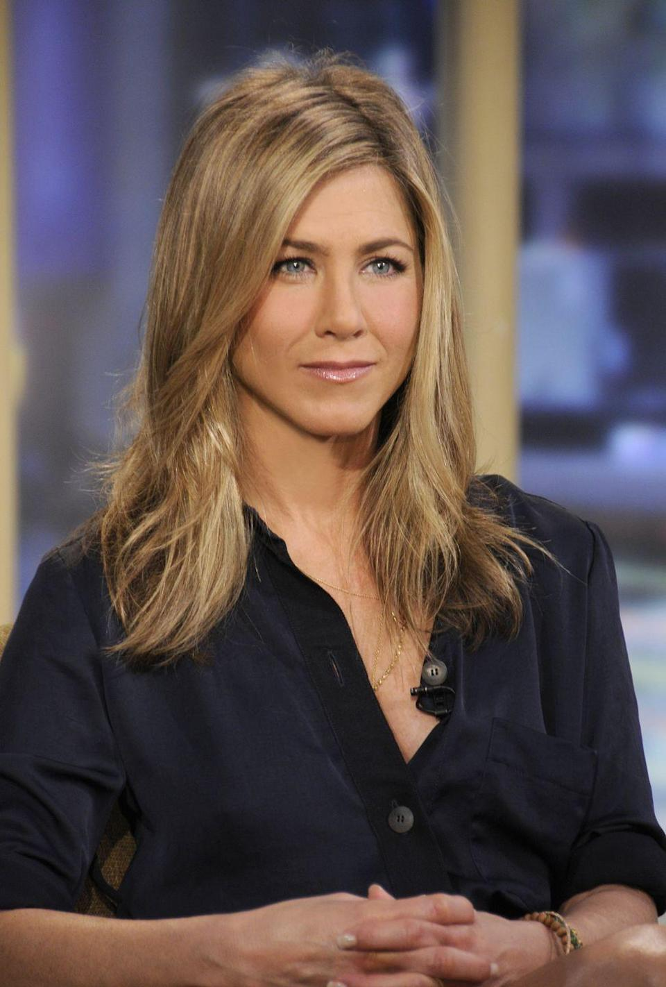 """<p>When Jen wakes up, she takes a mindful approach to her day. She told <a href=""""https://www.womenshealthmag.com/weight-loss/a29547718/jennifer-aniston-reese-witherspoon-intermittent-fasting/"""" rel=""""nofollow noopener"""" target=""""_blank"""" data-ylk=""""slk:Radio Times"""" class=""""link rapid-noclick-resp"""">Radio Times</a> that she has a celery juice and meditates before jumping into a workout.</p>"""