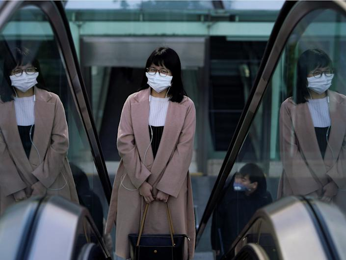 woman in Shanghai on first day back at work .JPG