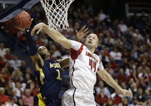 North Carolina A&T forward Adrian Powell (1) has his shot blocked by Louisville forward Stephan Van Treese (44) during the first half of a second-round game in the NCAA college basketball tournament, Thursday, March 21, 2013, in Lexington, Ky. (AP Photo/John Bazemore)
