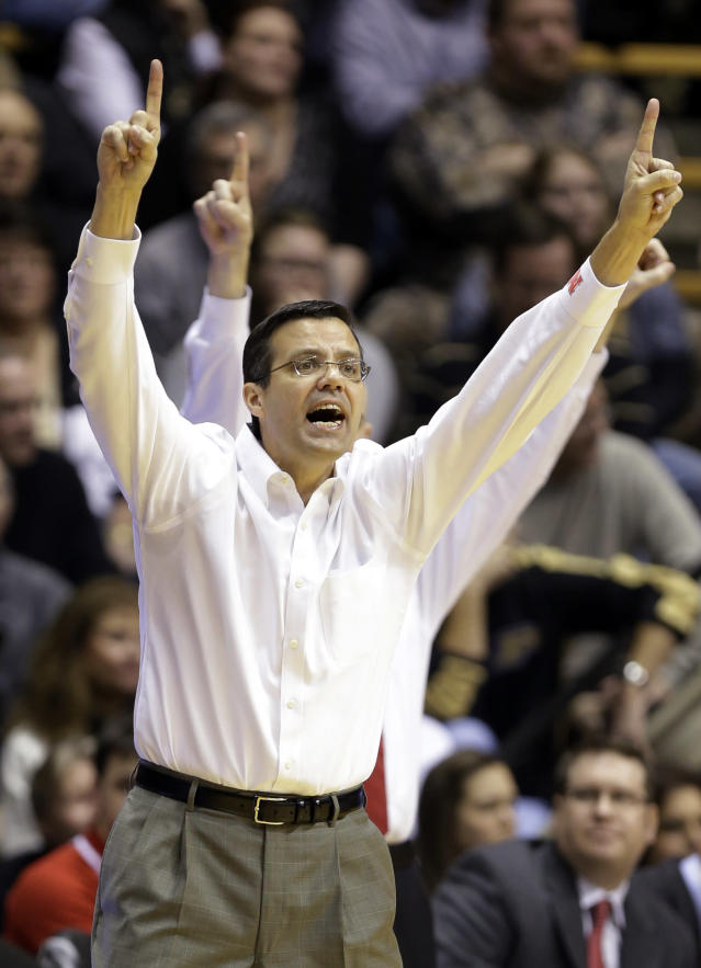 Nebraska head coach Tim Miles calls out to his team as the play Purdue in the second half of an NCAA college basketball game in West Lafayette, Ind., Sunday, Jan. 12, 2014. Purdue defeated Nebraska 70-64. (AP Photo/Michael Conroy)