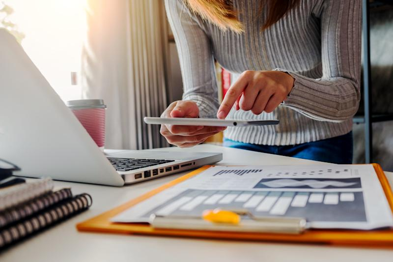 Midsection Of Businesswoman Using Digital Tablet In Office