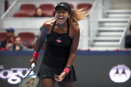 China Open: Tearful Naomi Osaka survives huge scare to reach Beijing semis