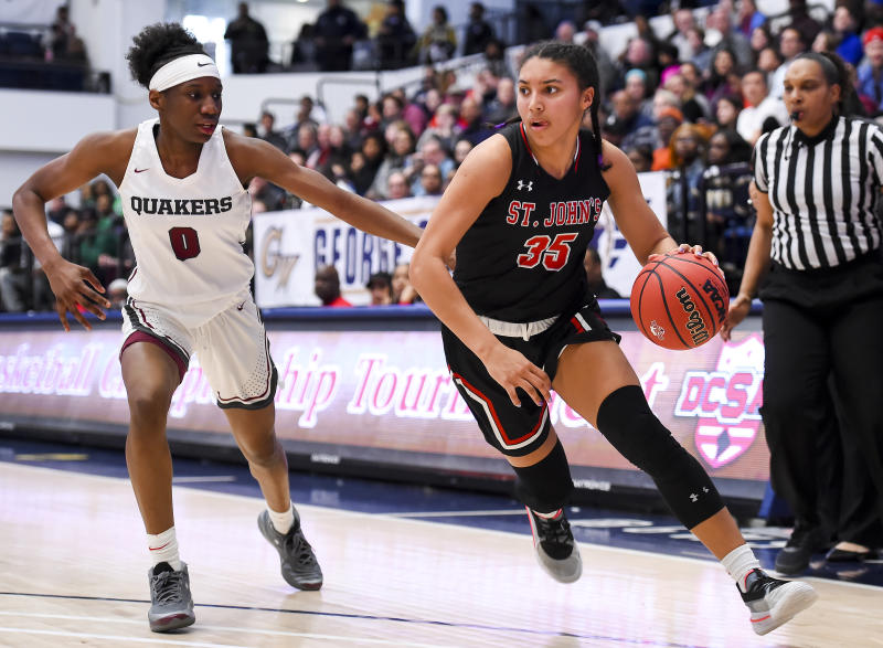 Azzi Fudd (R) St. John's dribbles in front of Jadyn Donovan of Sidwell Friends during a game on March 1, 2020. (Will Newton/Getty Images)