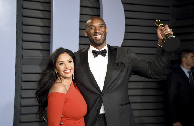 """Vanessa and Kobe Bryant, winner of the award for best animated short for """"Dear Basketball"""", arrive at the Vanity Fair Oscar Party on Sunday, March 4, 2018, in Beverly Hills, California. (Evan Agostini/Invision/AP)"""