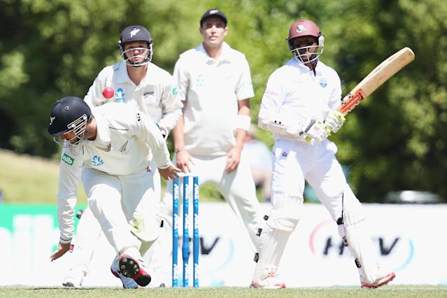 DUNEDIN, NEW ZEALAND - DECEMBER 05: Shivnarine Chanderpaul of the West Indies flicks the ball over the top of Hamish Rutherford during day three of the first test match between New Zealand and the West Indies at University Oval on December 5, 2013 in Dunedin, New Zealand. (Photo by Hannah Johnston/Getty Images)