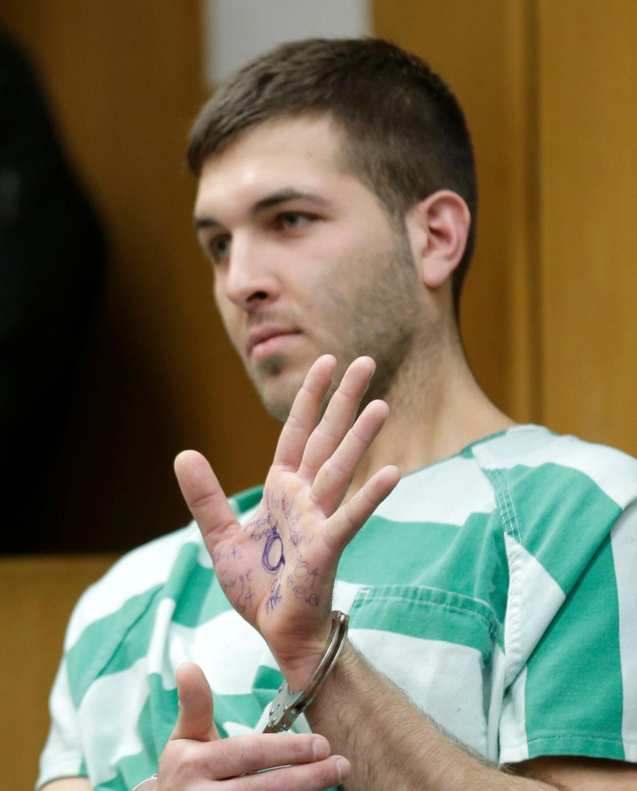 Comello displayed writing on his hand that included pro-Donald Trump slogans during his extradition hearing in Toms River, N.J., Monday, March 18, 2019. (AP Photo/Seth Wenig) (Photo: ASSOCIATED PRESS)