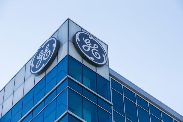 The General Electric logo is displayed at the top of their Global Operations Center in the Banks development of downtown Cincinnati. (AP Photo/John Minchillo, File)