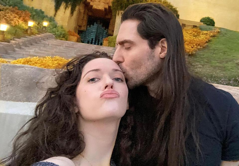 """<p>Dennings made her <a href=""""https://people.com/tv/kat-dennings-appears-to-confirm-new-romance-with-singer-andrew-w-k/"""" rel=""""nofollow noopener"""" target=""""_blank"""" data-ylk=""""slk:relationship with W.K."""" class=""""link rapid-noclick-resp"""">relationship with W.K.</a> Instagram official on May 3, posting a few sultry snaps of her 41-year-old beau <a href=""""https://www.instagram.com/p/CORlzoSHcF0/"""" rel=""""nofollow noopener"""" target=""""_blank"""" data-ylk=""""slk:on Instagram"""" class=""""link rapid-noclick-resp"""">on Instagram</a>. For any still wondering if that meant they were dating, she clarified with a <a href=""""https://www.instagram.com/p/COW8fbDH_ef/"""" rel=""""nofollow noopener"""" target=""""_blank"""" data-ylk=""""slk:photo"""" class=""""link rapid-noclick-resp"""">photo </a> of W.K. kissing her on the forehead. </p>"""