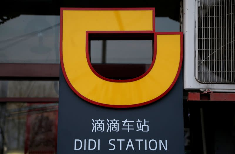 The logo of Didi Chuxing is seen at a Didi station in Beijing
