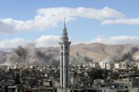 FILE PHOTO: Smoke rises from the besieged Eastern Ghouta in Damascus