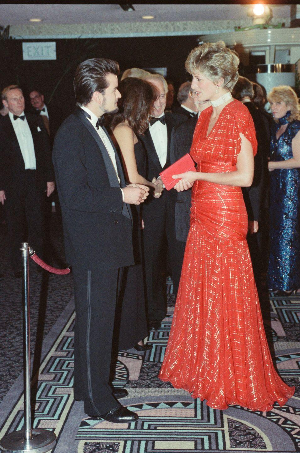 <p>Princess Diana rewore this red evening gown when she met Charlie Sheen at the London premiere of <em>Hot Shots</em>. Charlie kept it simple in a black tuxedo.</p>