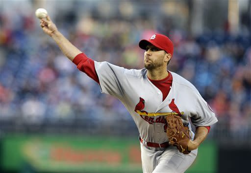 St. Louis Cardinals starting pitcher Adam Wainwright (50) throws during the first inning of a baseball game against the Washington Nationals at Nationals Park, Tuesday, April 23, 2013, in Washington. (AP Photo/Alex Brandon)