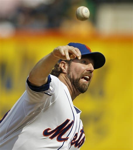 New York Mets starting pitcher R.A. Dickey, who is going for his 20th win of the season, delivers against the Pittsburgh Pirates during the first inning of a baseball game at Citi Field in New York, Thursday, Sept. 27, 2012. (AP Photo/Kathy Willens)