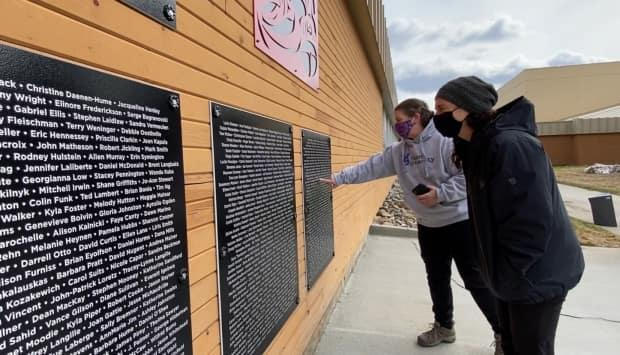Recognize anyone? The new installation in Whitehorse includes the names of more than 800 people who played a role at Yukon College over the years. (Philippe Morin/CBC - image credit)