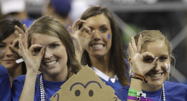 Kentucky fans cheer before an NCAA Final Four semifinal college basketball tournament game between Kentucky and Louisville Saturday, March 31, 2012, in New Orleans. (AP Photo/David J. Phillip)