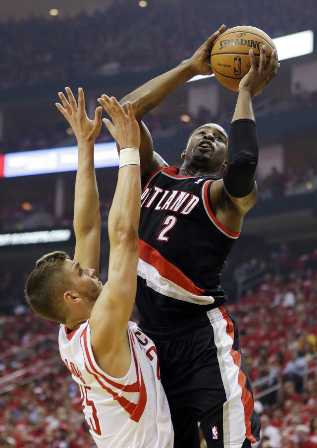 Portland Trail Blazers' Wesley Matthews (2) shoots over Houston Rockets' Chandler Parsons during the first half in Game 1 of an opening-round NBA basketball playoff series, Sunday, April 20, 2014, in Houston. (AP Photo/David J. Phillip)