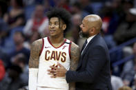 Cleveland Cavaliers head coach J.B. Bickerstaff talks to guard Kevin Porter Jr. (4) during a time out in the second half of an NBA basketball game in New Orleans, Friday, Feb. 28, 2020. (AP Photo/Rusty Costanza)
