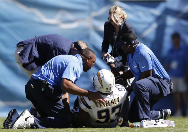 FILE - In this Sept. 29, 2013 file photo, San Diego Chargers outside linebacker Dwight Freeney is helped by Chargers personnel after being injured while playing the Dallas Cowboys during the first half of an NFL football game in San Diego. Chargers general manager Tom Telesco says Freeney has a torn quadriceps muscle. Telesco says the team doesn't yet know the severity of the injury or the time frame for recovery. (AP Photo/Gregory Bull, File)