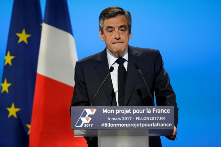 French Les Republicains presidential election candidate party Francois Fillon delivers a speech to present his programm during a campaign meeting in Aubervilliers, outside Paris, on March 4, 2017