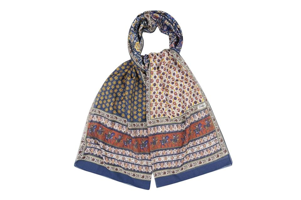 """<p>Is the spring-ready scarf as functional as its cozy wool counterparts? No. But that's not really the point. The point is how damn cool you'll look with this thing gently flapping around your neck in a brisk April breeze.</p> <p><em>Drake's patchwork Mughal rider print cotton-linen scarf</em></p> $255, Drake's. <a href=""""https://www.drakes.com/usa/accessories/scarves/ecru-and-terracotta-patchwork-mughal-rider-print-cotton-linen-scarf"""" rel=""""nofollow noopener"""" target=""""_blank"""" data-ylk=""""slk:Get it now!"""" class=""""link rapid-noclick-resp"""">Get it now!</a>"""