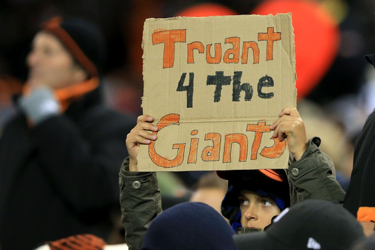 "DETROIT, MI - OCTOBER 28:  A San Francisco Giants fans holds a sign that reads, ""Truant 4 The Giants"" during Game Four of the Major League Baseball World Series against the Detroit Tigers at Comerica Park on October 28, 2012 in Detroit, Michigan.  (Photo by Doug Pensinger/Getty Images)"