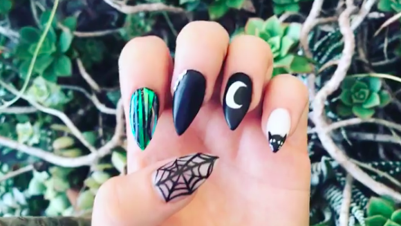 """<p><a rel=""""nofollow"""" href=""""https://www.instagram.com/p/BLhhiLvjQn2/?taken-by=ashkaylaa"""">@ASHKAYLAA </a> — It's kind of hard not to fall in love with the gorgeously painted spiderweb alongside the pretty little kitty on the pinky. </p>"""
