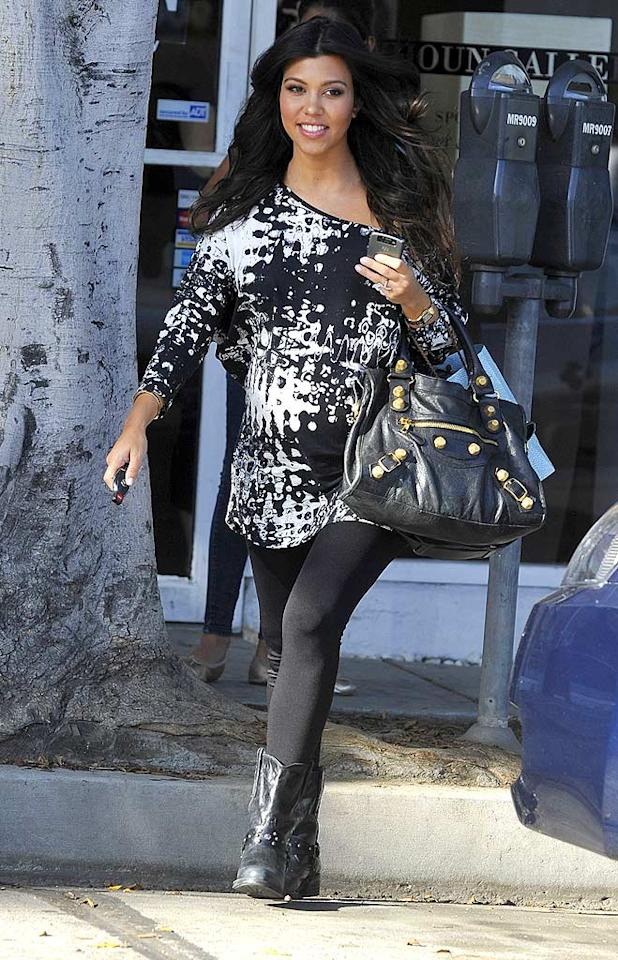 """Kourtney Kardashian is another E! reality star expecting around the holidays. Although the Kardashians were surprised to learn she was pregnant, everyone is anxiously awaiting the arrival of a new baby boy! TC/HSW/<a href=""""http://www.splashnewsonline.com/"""" target=""""new"""">Splash News</a> - October 1, 2009"""