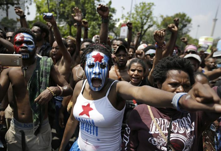 "A Papuan activist with her face painted with the colors of the separatist Morning Star flag joins others at a rally near the presidential palace in Jakarta, Indonesia, in 2019. <span class=""copyright"">(Dita Alangkara / Associated Press)</span>"