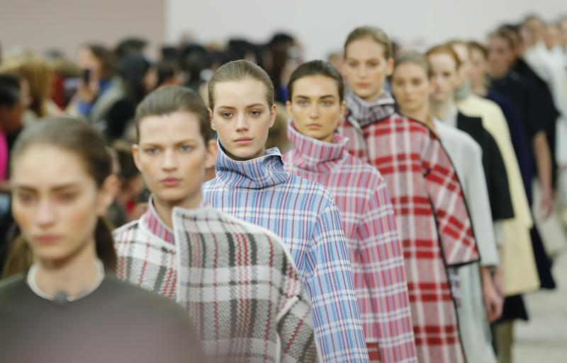 Models present creations for Celine's Ready to Wear Fall-Winter 2013-2014 fashion collection, presented Sunday, March 3, 2013 in Paris. (AP Photo/Jacques Brinon)