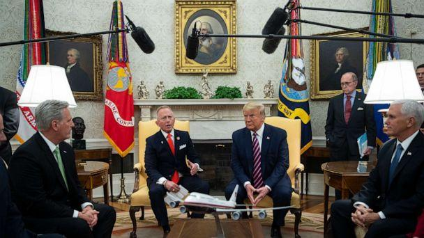 PHOTO: President Donald Trump listens as Rep. Jeff Van Drew, D-N.J., who is planning to switch his party affiliation, speaks during a meeting in the Oval Office of the White House, Dec. 19, 2019, in Washington. (Evan Vucci/AP)