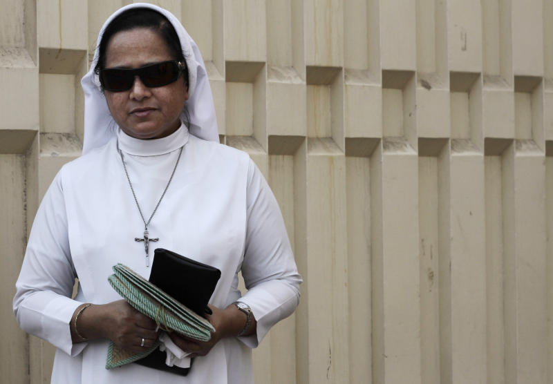 In this Thursday, Aug. 30, 2012 photo, a Bahraini nun stands near the gate of Sacred Heart Church in Manama, Bahrain. When Bahrain announced plans to build the largest Roman Catholic Church in the Gulf, it was accompanied by a noticeable dose of pride to showcase its traditions of religious tolerance. Instead, the planned church has turned into another point of tension in a country already being pulled apart by internal sectarian battles. (AP Photo/Hasan Jamali)