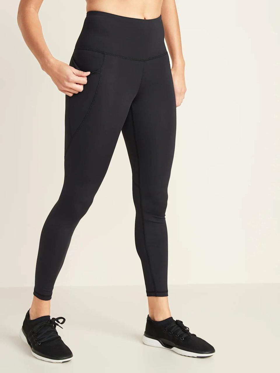 """<p>""""I knew after my first workout these <span>High-Waisted Elevate Powersoft 7/8-Length Side-Pocket Leggings</span> ($30, originally $40) would be a pant I'd be buying time and time again. They're incredibly easy to slide on and don't require additional tugging at the thigh or waistband in order to get them on the way other tights I own do. And my absolute favorite aspect of these tights is, of course, the deep pockets. My iPhone, keys, and small zip wallet all fit inside the pockets and don't budge while running, which is no easy feat. I've done burpees and jumping jacks and gone on at least a dozen runs in them, and nothing has ever fallen out."""" - Rebecca Brown, contributor</p> <p>Read the full <a href=""""https://www.popsugar.com/fitness/best-workout-leggings-with-pockets-at-old-navy-review-47474723"""" class=""""link rapid-noclick-resp"""" rel=""""nofollow noopener"""" target=""""_blank"""" data-ylk=""""slk:Old Navy High-Waisted Elevate Powersoft 7/8-Length Side-Pocket Leggings review"""">Old Navy High-Waisted Elevate Powersoft 7/8-Length Side-Pocket Leggings review</a>.</p>"""