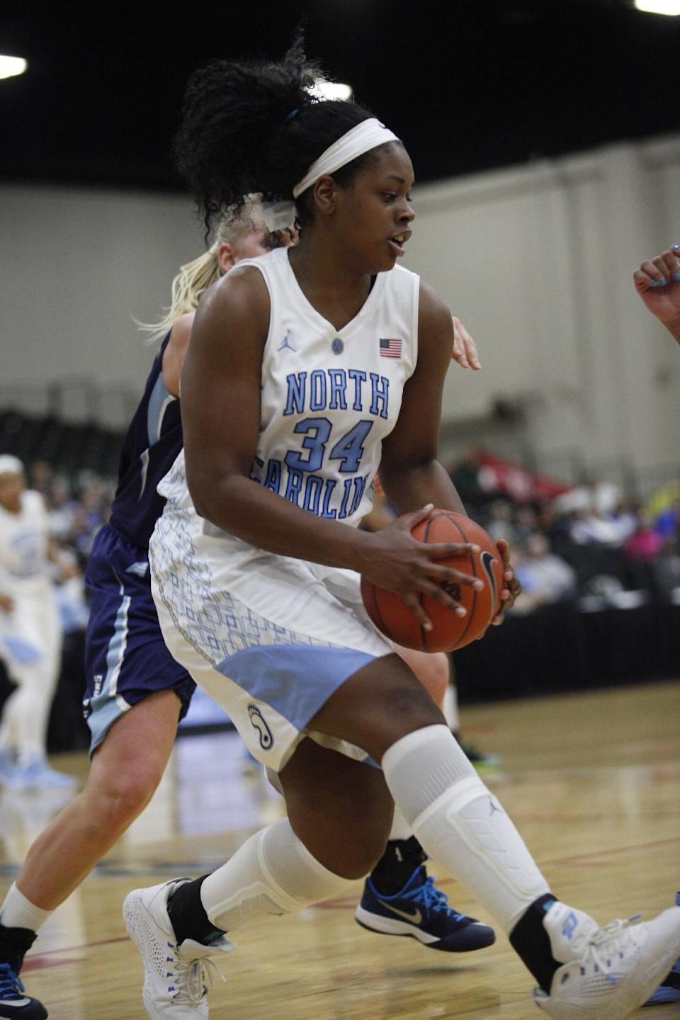 North Carolina's Xylina McDaniel (34) grabs a rebound against Maine during the first half of an NCAA college basketball game, Friday, Dec. 19, 2014 in Myrtle Beach, S.C. (AP Photo/Randall Hill)
