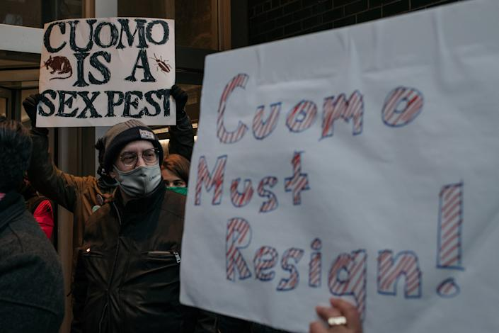 Demonstrators demanding that New York Governor Andrew Cuomo resign from office hold signs and chant at a rally on March 2, 2021 in New York City. (Scott Heins/Getty Images)