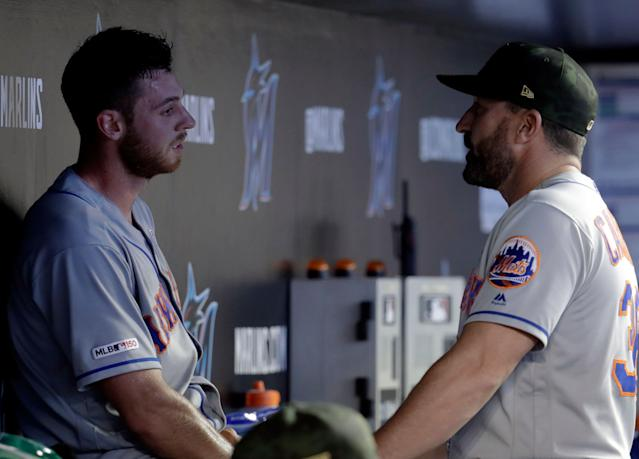 New York Mets starting pitcher Steven Matz, left, left talks with manager Mickey Callaway after being relieved in the fourth inning during a baseball game against the Miami Marlins, Saturday, May 18, 2019, in Miami. (AP Photo/Lynne Sladky)