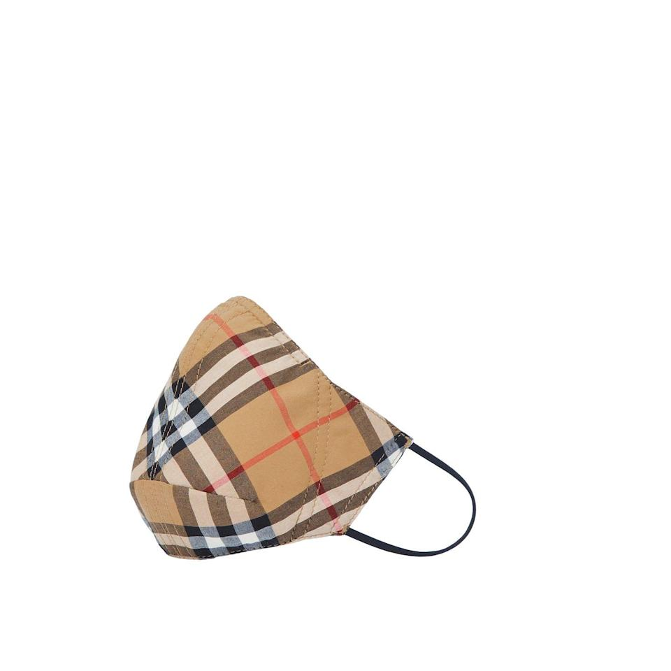 """<p>Up his mask game with Burberry's fine vintage check pattern. Sustainably sourced from revalued fabric, 20 per cent of the sale price goes straight to the Burberry Foundation Covid-19 Community Fund – an excellent initiative established last year for global employees and partners to support local communities in need.</p><p>£90, <a href=""""https://uk.burberry.com/vintage-check-cotton-face-mask-p80407551"""" rel=""""nofollow noopener"""" target=""""_blank"""" data-ylk=""""slk:Burberry"""" class=""""link rapid-noclick-resp"""">Burberry</a>.</p>"""