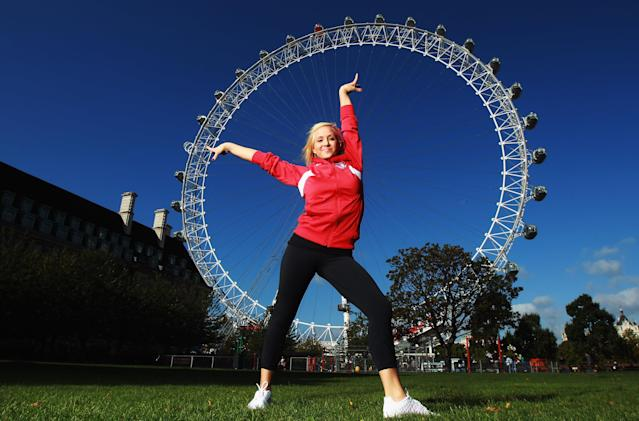 LONDON, ENGLAND - SEPTEMBER 13: Gymnast Nastia Liukin of the USA poses by the London Eye during a tour of London on September 13, 2011 in London, England. (Photo by Bryn Lennon/Getty Images for USOC)