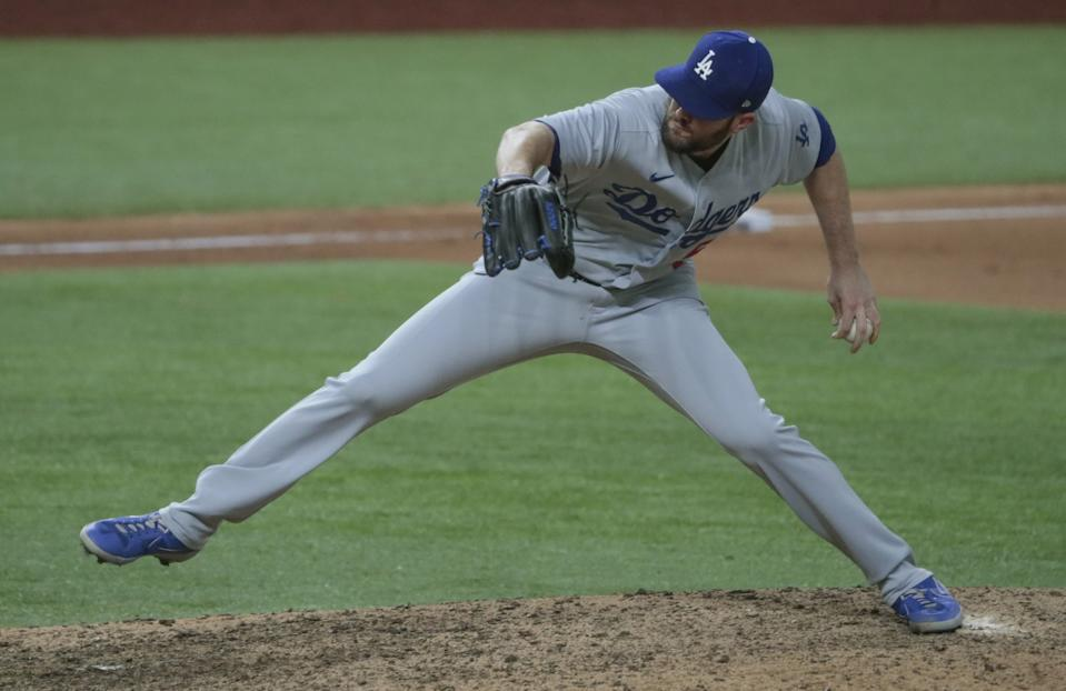 The Dodgers' Alex Wood pitches during the NLCS.