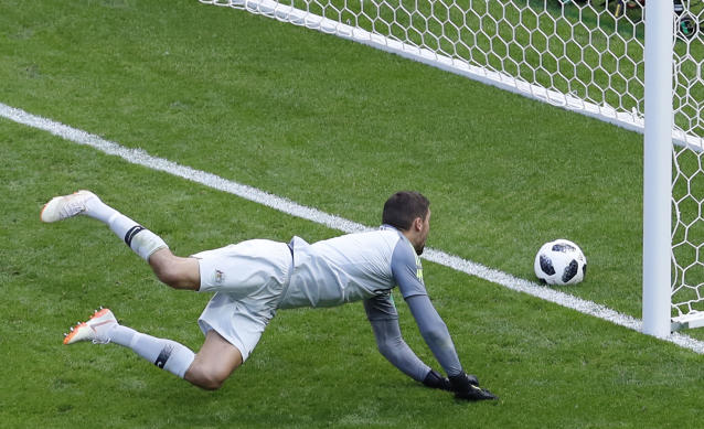 Australia goalkeeper Mathew Ryan fails to save the ball as France's Paul Pogba his side's second goal during the group C match between France and Australia at the 2018 soccer World Cup in the Kazan Arena in Kazan, Russia, Saturday, June 16, 2018. (AP Photo/Hassan Ammar)