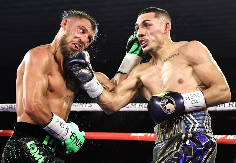 LAS VEGAS, NEVADA - OCTOBER 17: In this handout image provided by Top Rank, Vasiliy Lomachenko fights Teofimo Lopez Jr in their Lightweight World Title bout at MGM Grand Las Vegas Conference Center on October 17, 2020 in Las Vegas, Nevada. (Photo by Mikey Williams/Top Rank via Getty Images)