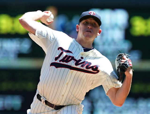 Minnesota Twins pitcher Kevin Correia throws against the Chicago White Sox in the first inning of a baseball game, Saturday, June 21, 2014, in Minneapolis. (AP Photo/Jim Mone)