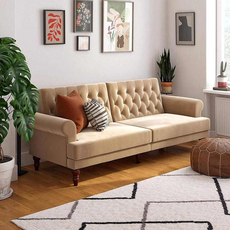 <p>This luxe <span>Novogratz Upholstered Cassidy Convertible Couch</span> ($379) looks so comfy.</p>