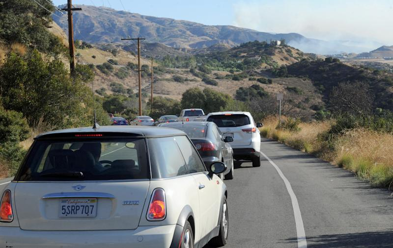 The Saddleridge fire comes across the mountains near Chatsworth and Highway 118 on Friday, Oct. 11, 2019. Commuters used the Santa Susana Pass Road near Simi Valley because portions of Highway 118 was closed.