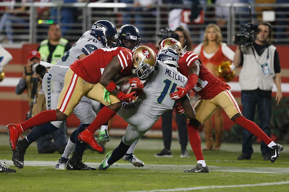 Jaquiski Tartt (29) of the San Francisco 49ers strips the ball from D.K. Metcalf of the Seattle Seahawks. (Photo by Lachlan Cunningham/Getty Images)