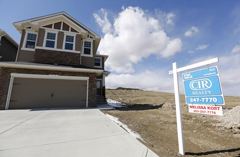 A newly built house for sale is seen in Calgary, Alberta, April 7, 2015. House prices have fallen in Calgary after the price of oil plummeted late last year according to local media. REUTERS/Todd Korol