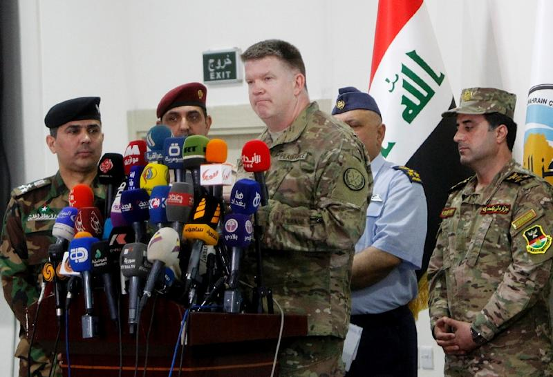Colonel John Dorrian, the spokesman for the US-led international coalition against the Islamic State group, holds a press conference in the Iraqi capital Baghdad on May 16, 2017 (AFP Photo/SABAH ARAR)
